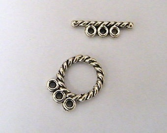 Clasp toogle silver braided effect