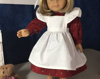 Burgandy dress with white ruffle pinafore