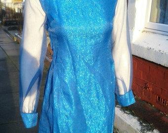 Cute 1960s blue lurex dress with sheer sleeves