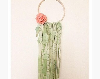 Green dreamcatcher with coral flower