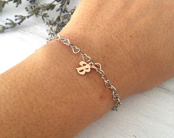 Steel bracelet with steel chain and pink gold initials