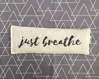 Just Breathe Eye pillow filled with organic lavender and Australian brown rice / geo backing fabric in grey.  Great for yoga & meditation