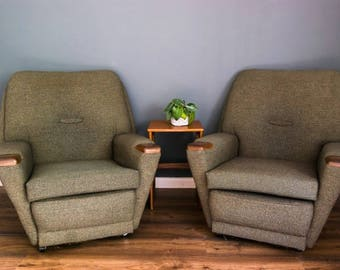 A pair of mid century armchairs