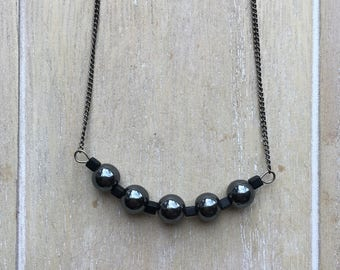 Long gunmetal necklace with dark hematite beads.