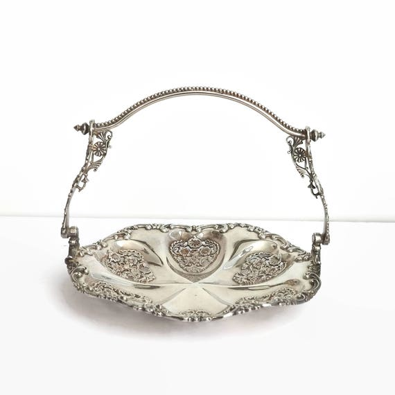 Silver plated serving tray with swing handle, highly decorative open metal work pattern of flowers, scrolls, shells, mid 20th century