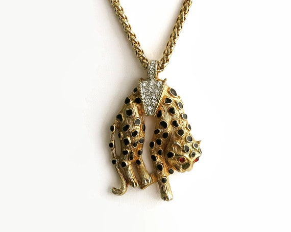Kenneth Jay Lane leopard pendant necklace with rhinestones and black enamel, Cartier style replica, spiga chain, gold tone metal, 1990s