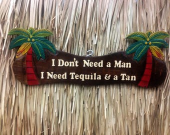 I don't need a man, I need tequila and a tan wall sign