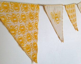 Beautiful bee bunting. Hand printed and hand sewn.