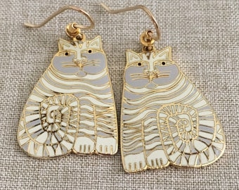 """Gold Tone Laurel Burch Vintage """"SHAMBALA"""" White And Lavender Earrings - Dark Areas on front are from the camera"""
