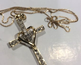 """Vintage 14kt Diamond cross and chain 18"""" in length the Diamond cross (measures 1 1/2"""" in length and 7/8"""" in width )  3.5 Grams total"""