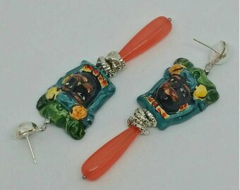 Dangling Sicilian puppets Moors with coral drops