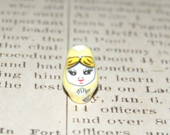 Russian doll 22x13mm yellow ceramic bead