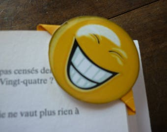 Yellow bookmarks and a familiar face yellow which smile with full teeth.