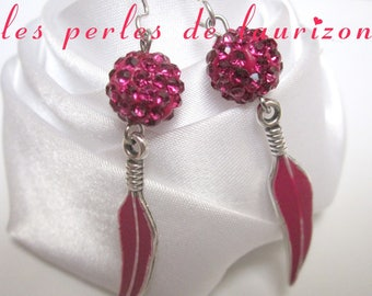 These earrings a feather rhinestone