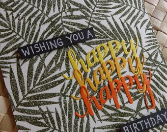 "Tropical happy birthday card with embossed palm foliage background: ""Wishing you a happy happy happy birthday!"""