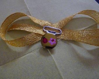 Ladybug flower metal pacifier clip.