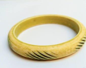 Vintage carved lucite bangle