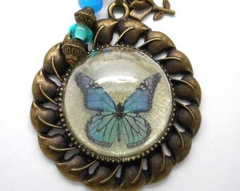 Necklace blue green Butterfly half globe spun beads