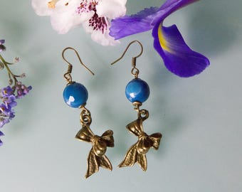Earrings: Blue Agate, bronze metal bow.