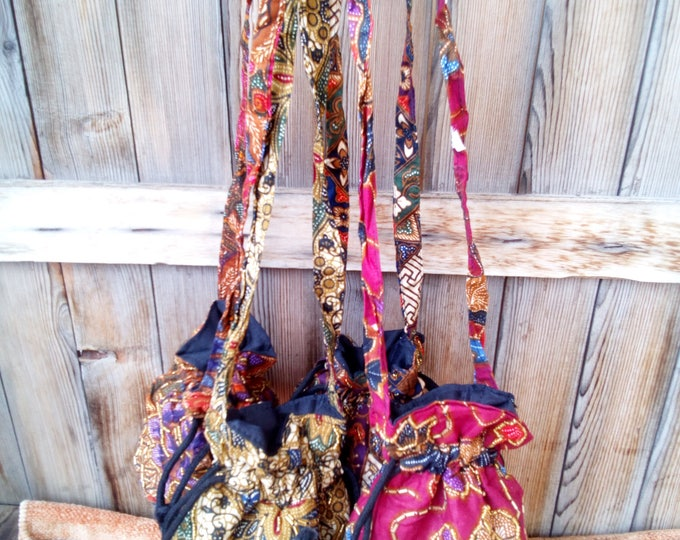 100% cotton hand embroidered pouches vivid colours stylish trendy boho style ruffled top with long fabric strap everyday wear bymademeathens
