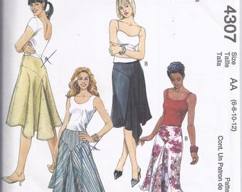 McCalls Pattern 4307 from 2003,  Misses Skirts with Yokes and Godets.  Waist 23-24