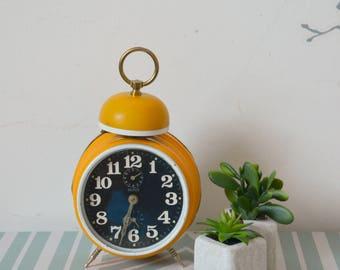 Vintage yellow, mechanical alarm clock, clock