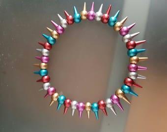 Elastic bracelet metallic stick beads
