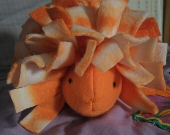 Orange and White Stuffed Hedgehog