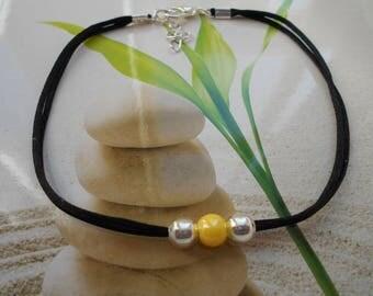 Black bead cord ankle bracelet yellow ceramic