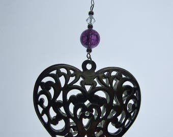 Metal Heart with beads hanging for Valentines Day.