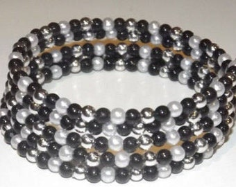 Bracelet of glass beads on 5-row memory wire, black, grey, silver and white