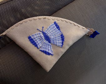 "Kit, ""blue butterfly"" embroidered on suede hand purse"