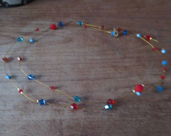 Blue, red diamond pearl necklace.