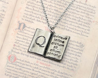 """The pendant """"The Old book"""" with a wise Latin saying. From the nickel silver on the chain. Open mini book pendant."""