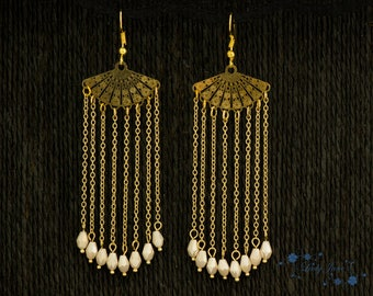 Outstanding long chandelier with fan and chains of gold plated and beige glass beads