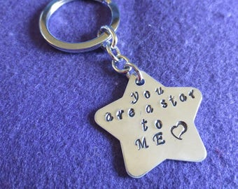 "Key chain with a star saying, ""you are a star to me"""