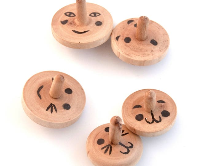 Set of three spinning tops with faces