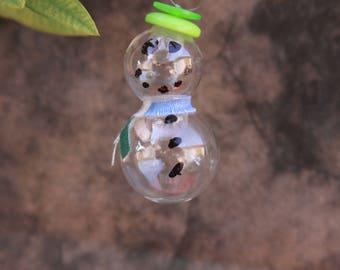 A handful of glass snowmen