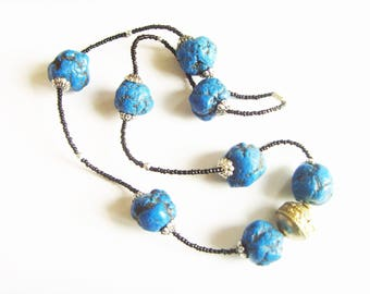 Necklace silver blue black beads.