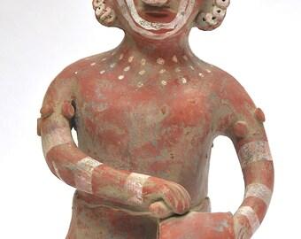 Pre-Columbian clay statue