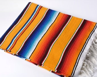 Mexican blanket or serape in yellow