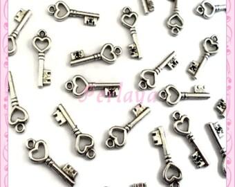 Lot de 50 breloques clefs argentées 2cm REF2252