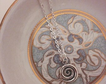 Simple necklace with spiral shaped pendant