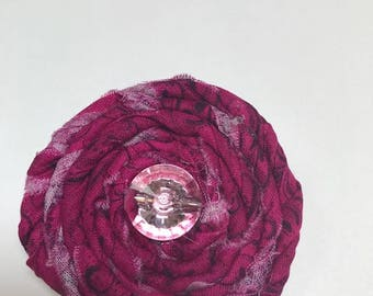 Wine colored rolled fabric flower