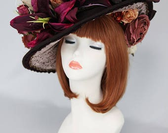 A wine red hat decorated with a lot of flowers