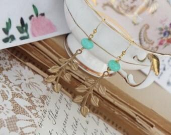 leaf and stone earrings.