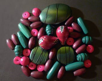 44 wooden beads and resin green, pink, plum of various shapes