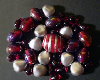 35 Indian Silver of various shapes, red glass beads