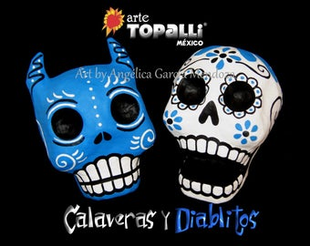 Couple of Beautiful Devil and Skull, Paper mache. Day of the dead. Mexican art. Pareja Diablo y Calavera, papel maché. Día de los muertos