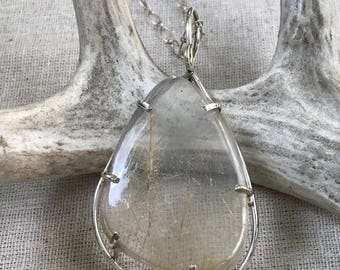 Rutilated Quartz pendant on a sterling silver chain